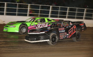 Josh Coonradt and Jason Casey battle for position